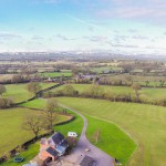 Panoramic aerial photograph of Birch Hill Caravan Club CL - looking West towards Wales