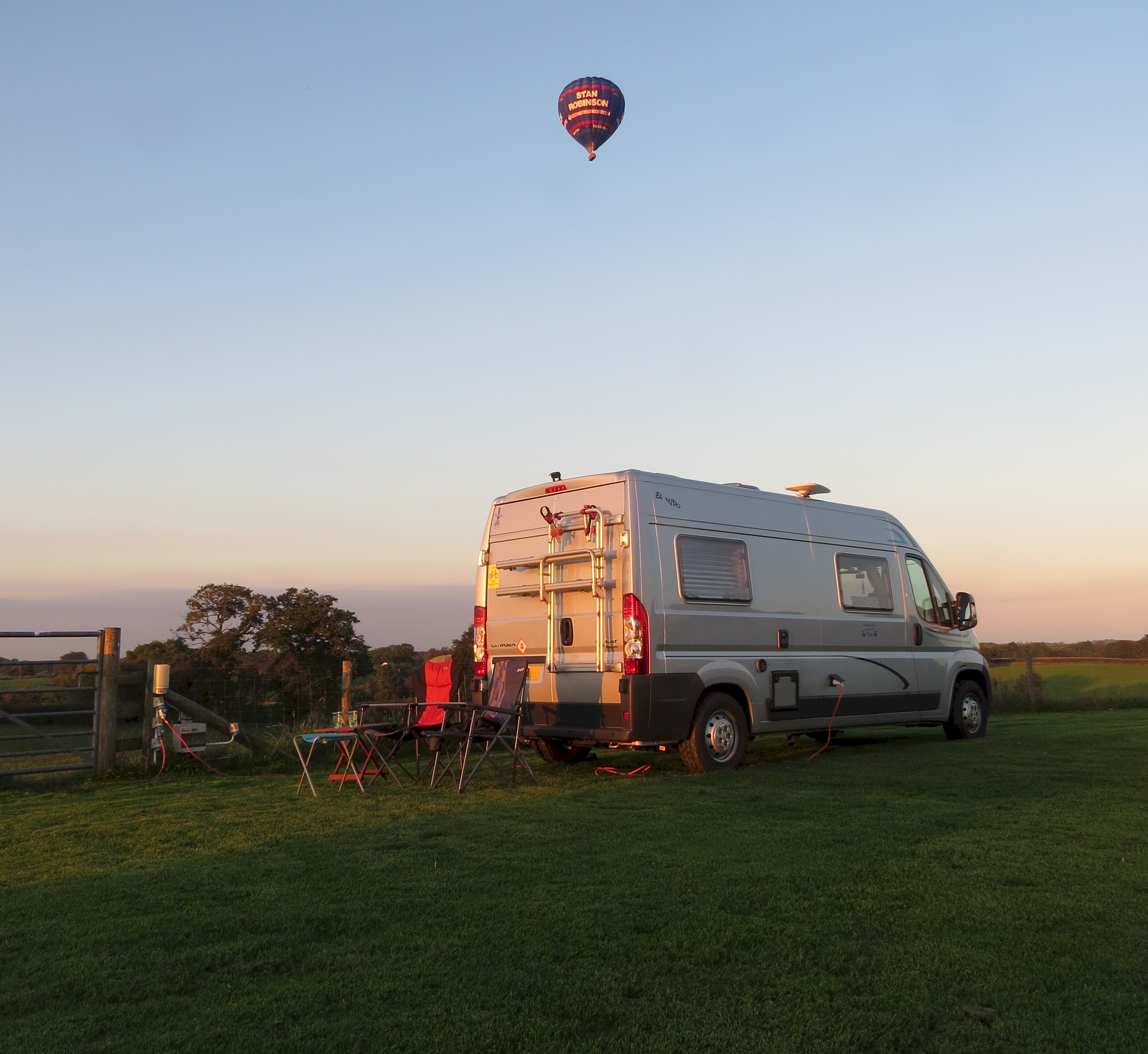 Hot air balloon over motorhome